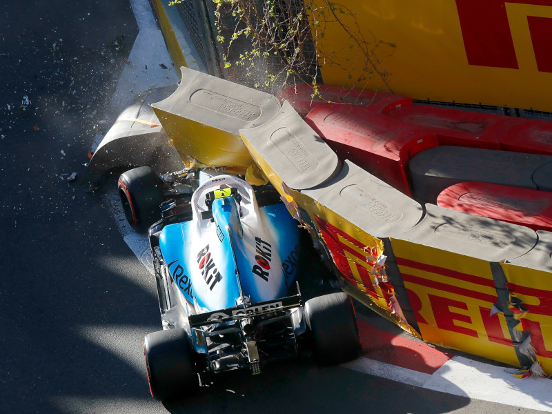 George Russell's FW42 on a low-loader following hitting a drain cover at Baku