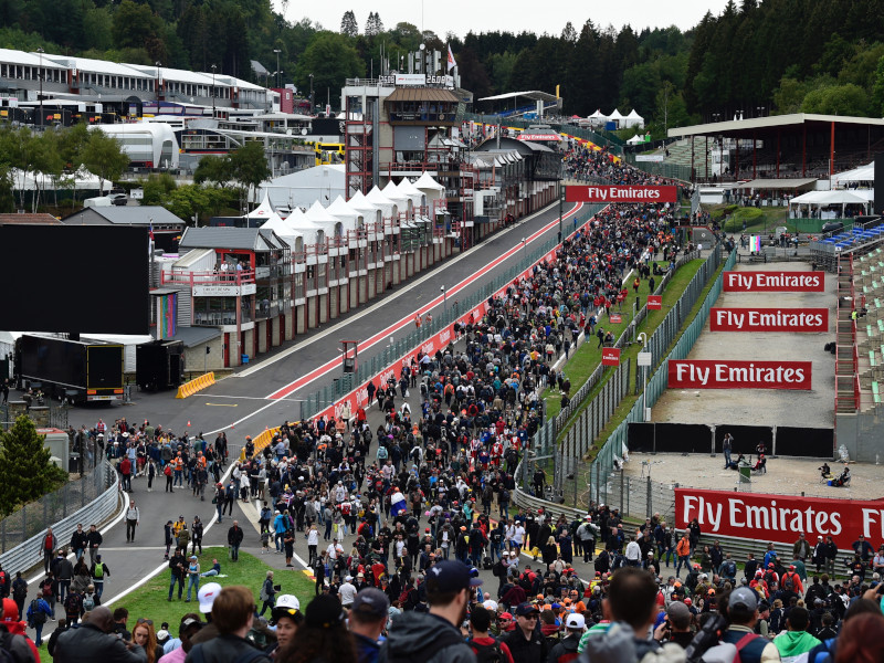 Fans flock onto the circuit after the Belgian GP